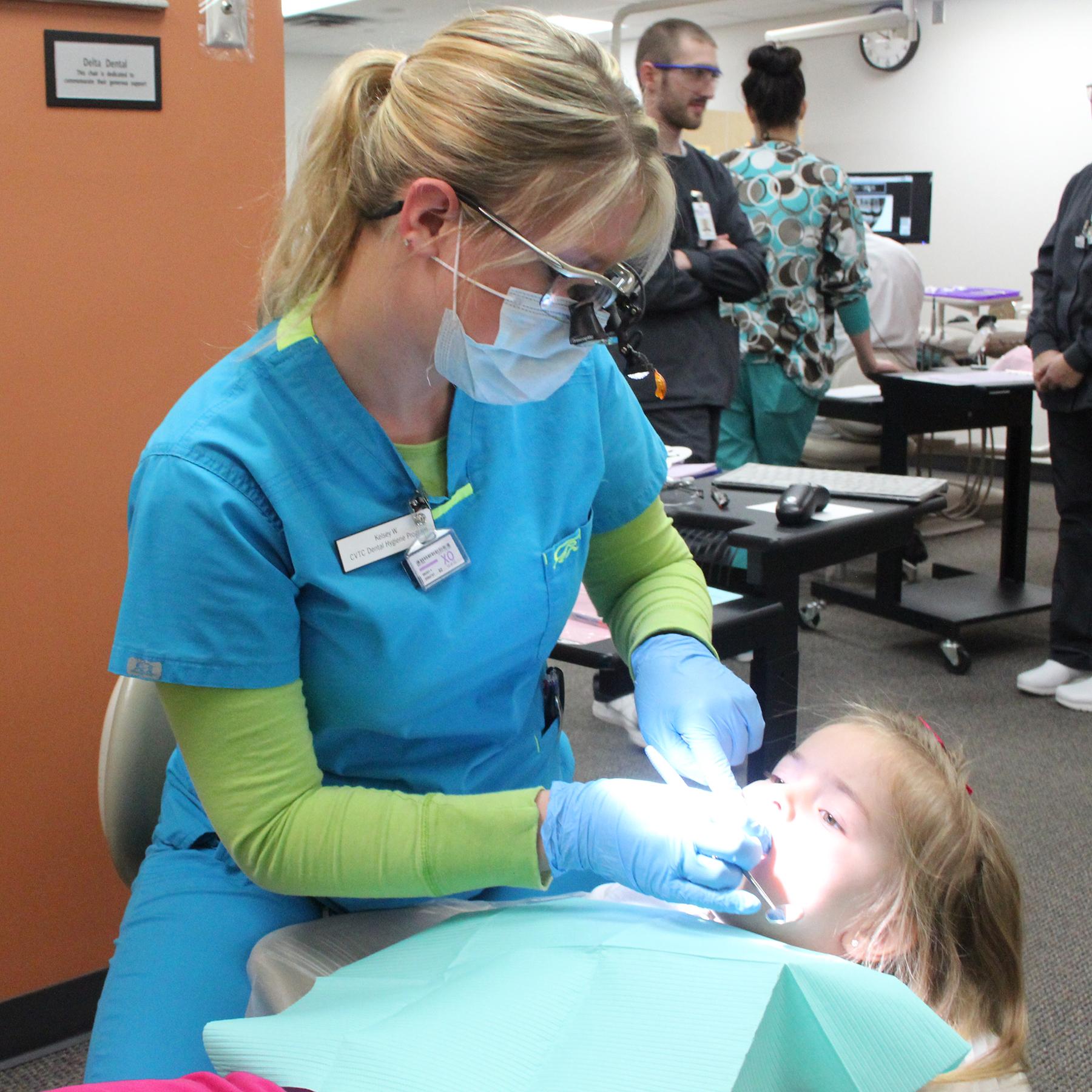 CVTC Dental Hygienist Student Kelsey Wirth Cleans The Teeth Of Anya Adkins 4