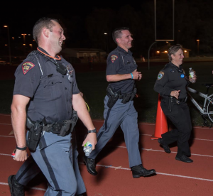 Retired UW-Stout Police Chief Lisa Walter, right, participates in a 2015 Run with Cops event to raise money for Special Olympics.