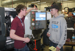 CVTC Machine Tooling Technics student Hunter Sullivan, left, of Chippewa Falls, explains the capabilities of the CNC machine to Colfax High School junior Cole Hill at the CVTC Manufacturing Show March 2.
