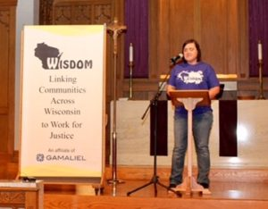 "Sarah Ferber, JONAH organizer for EXPO in Eau Claire, speaks at Bethel Lutheran Church in Madison during last month's ""Action Day."" (Photo courtesy of WISDOM)"